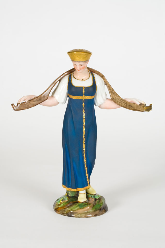 A Russian figurine of a dairy maid carrying a yoke, early 19th century