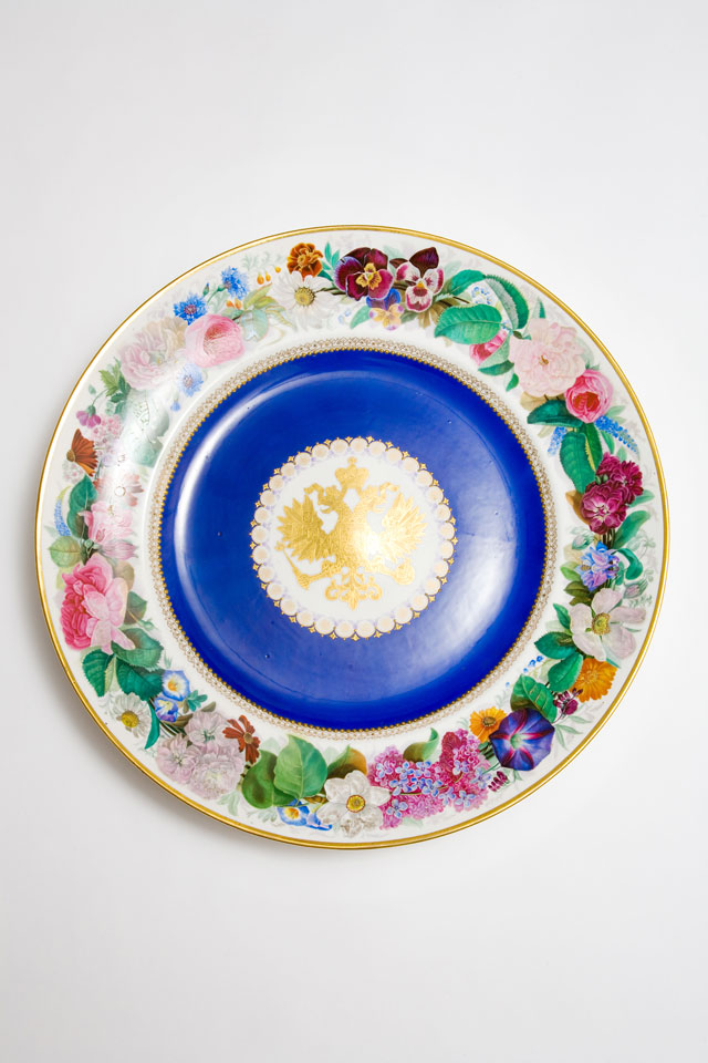 Large, circular Popov porcelain dish with gilt Russian eagle reserved on dark blue ground and rim decorated with brightly painted flowers
