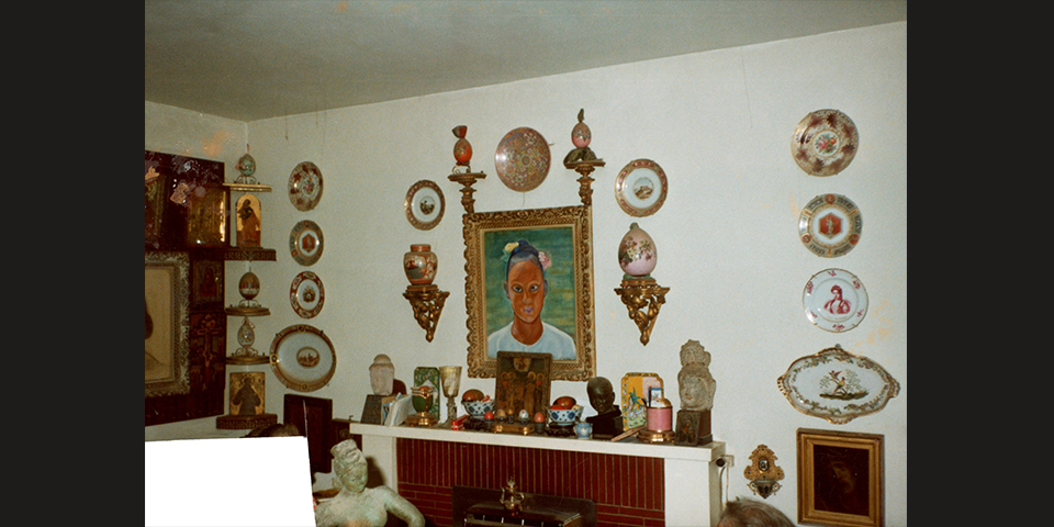 Display over the fireplace in the Dorich House living room, c.1980s. © Historic England